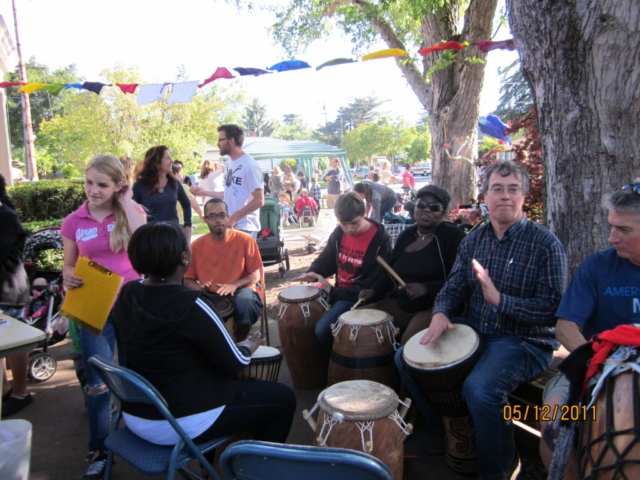 our neighbors from Ghana, Adua Kudoto and daughter, Sena lead drum circle