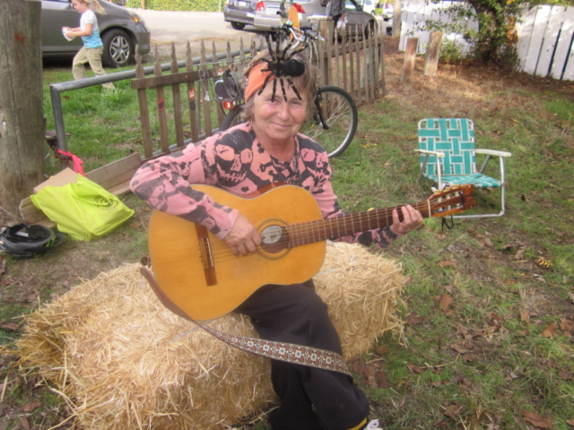 neighbor with spider and guitar